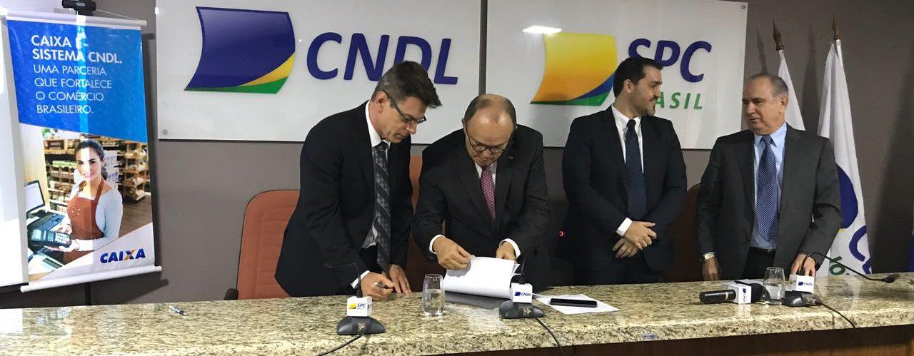 CNDL E CAIXA ASSINAM ACORDO DE COOPERAÇÃO